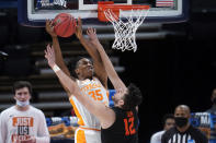 Oregon State center Roman Silva (12) defends Tennessee guard Yves Pons (35) during the second half of a men's college basketball game in the first round of the NCAA tournament at Bankers Life Fieldhouse in Indianapolis, Friday, March 19, 2021. (AP Photo/Paul Sancya)