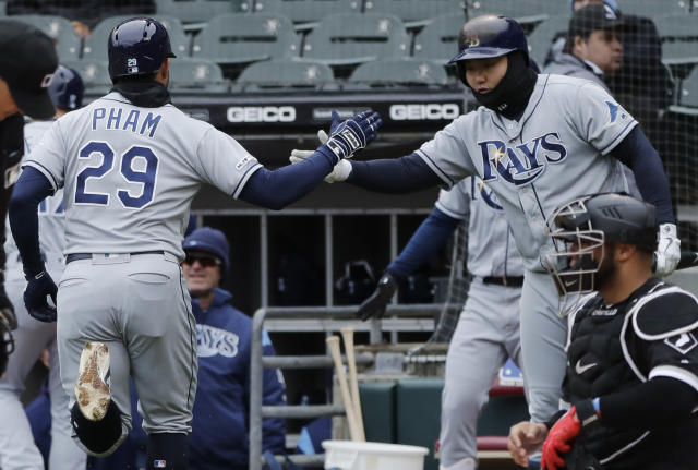 Tampa Bay Rays' Tommy Pham, left, celebrates with Ji-Man Choi, of South Korea, after hitting a two-run home run as Chicago White Sox catcher Welington Castillo looks to the field during the first inning of a baseball game in Chicago, Wednesday, April 10, 2019. (AP Photo/Nam Y. Huh)