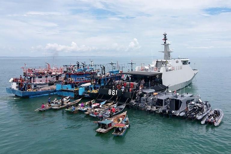 Fishermen got doses of Covid-19 vaccines onboard an Indonesian naval ship off the coast of southern Riau