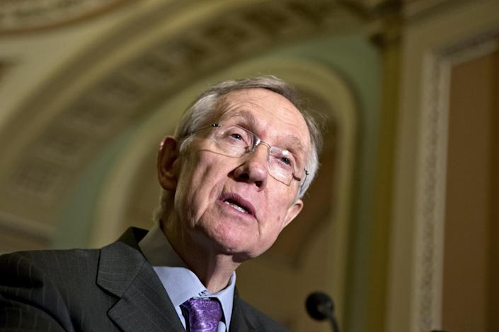 Senate Majority Leader Harry Reid of Nev. speaks with reporters on Capitol Hill in Washington, Tuesday, Nov. 27, 2012, following a Democratic strategy session. (AP Photo/J. Scott Applewhite)