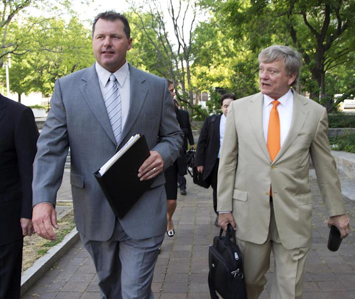 Former Major League Baseball pitcher Roger Clemens, and his attorney Rusty Hardin, arrive at federal court in Washington in Washington, Monday, April 16, 2012, for jury selection in the perjury trial on charges that he lied when he told Congress he never used steroids and human growth hormone. (AP Photo/Manuel Balce Ceneta)
