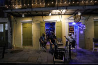 Patrons resume their socializing at Cuban Creations Cigar Bar in the French Quarter in New Orleans, after power was restored Wednesday, Oct. 28, 2020. Hurricane Zeta passed through earlier Wednesday, leaving much of the city and metro area without power. (AP Photo/Gerald Herbert)