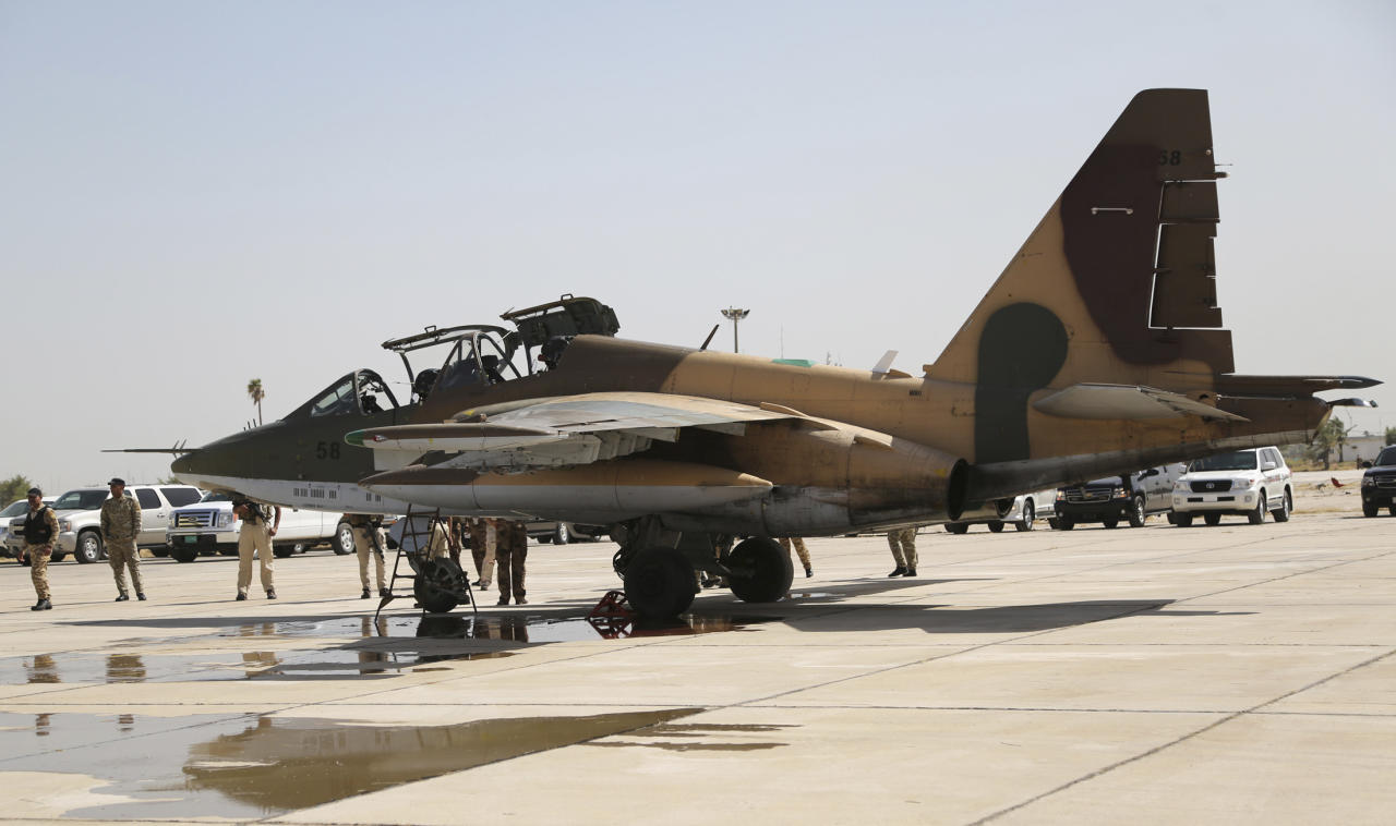 A Russian Sukhoi Su-25 fighter plane arrives at Iraq's al-Muthanna military airbase at Baghdad airport, in Baghdad, July 1, 2014. Iraq's defence ministry said on Tuesday that the second batch of Russian Sukhoi (Su-25) fighter jets that arrived in Baghdad will be used to back Iraqi troops that continue to battle Islamic State militants, previously known as the Islamic State of Iraq and the Levant (ISIL), in the country's northern provinces. REUTERS/Stringer (IRAQ - Tags: CIVIL UNREST POLITICS TRANSPORT MILITARY CONFLICT TPX IMAGES OF THE DAY)