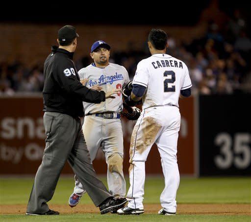Los Angeles Dodgers left fielder Shane Victorino runs in from left field to confront San Diego Padres' Everth Cabrera after Cabrera's hard slide into Dodgers second baseman Mark Ellis during ther seventh inning of a baseball game Tuesday, Sept. 25, 2012 in San Diego. Umpire Mark Ripperger steps between the players. (AP Photo/Lenny Ignelzi)