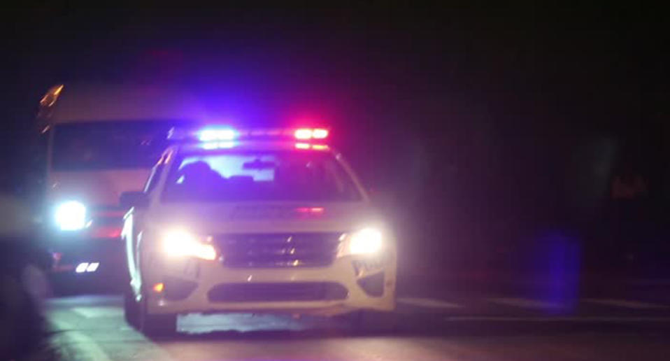 A police car seen with sirens and flashing lights.