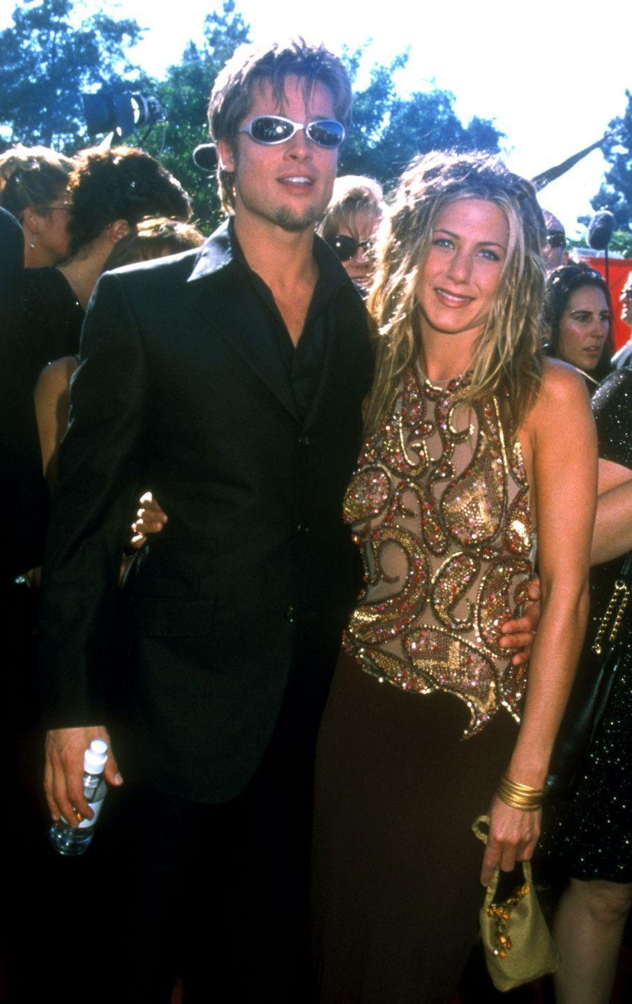 <p>Pitt and Aniston make their public debut as a couple on the red carpet for the Emmy Awards in 1999—forever immortalizing Brad's sunglasses.</p>