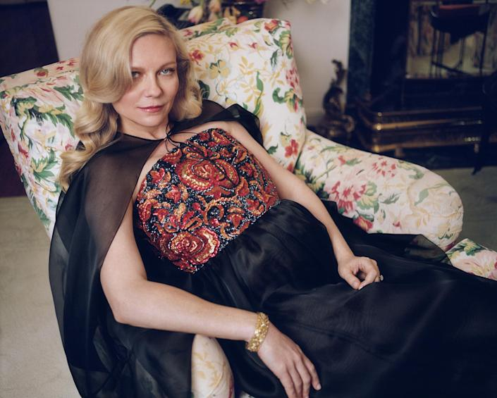 Kirsten Dunst in a Chanel cape and dress (Zoe Ghertner / W Magazine)