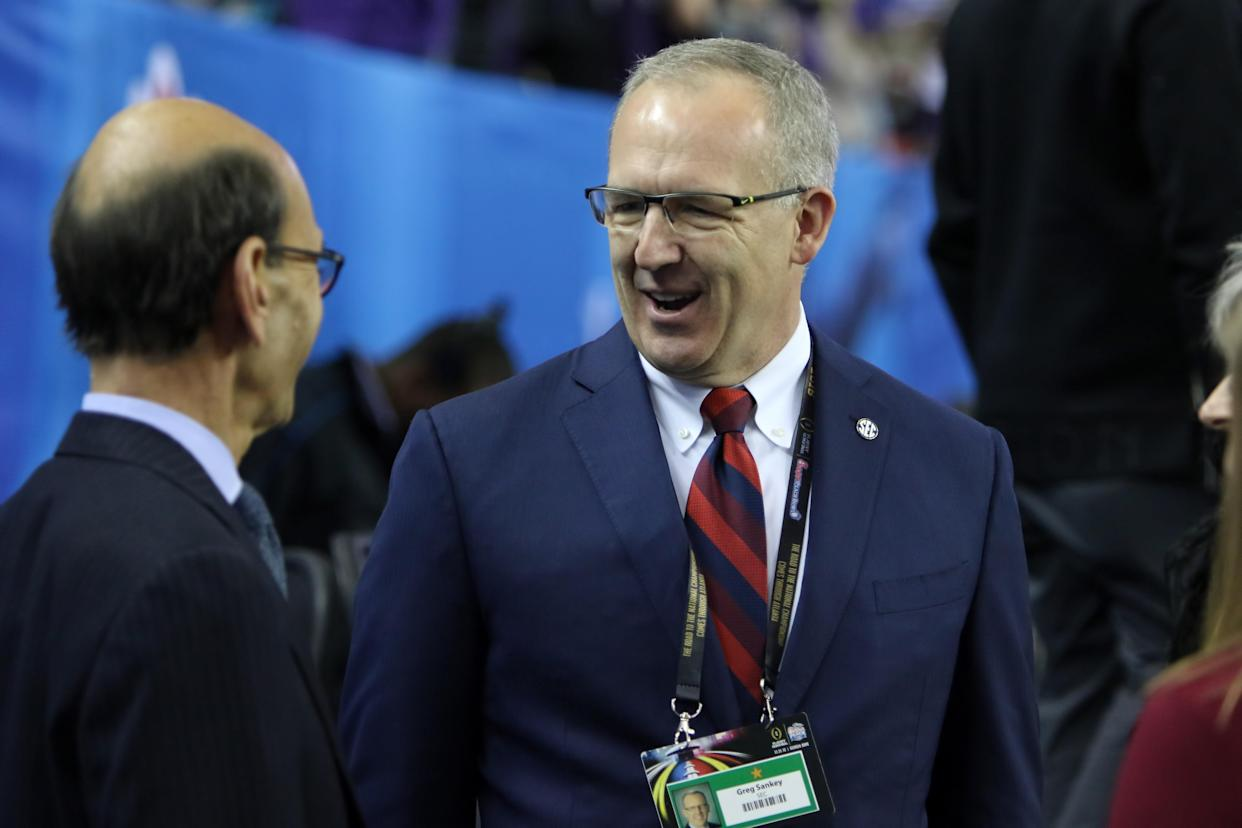 ATLANTA, GA - DECEMBER 31:   SEC Commissioner, Greg Sankey, talks with ESPN Analysy, Paul Finebaum, at the College Football Playoff Semifinal at the Chick-fil-A Peach Bowl between the Washington Huskies and the Alabama Crimson Tide on December 31, 2016.  Alabama defeated Washington by the score of 24-7 at the Georgia Dome in Atlanta, Georgia.  (Photo by Michael Wade/Icon Sportswire via Getty Images)