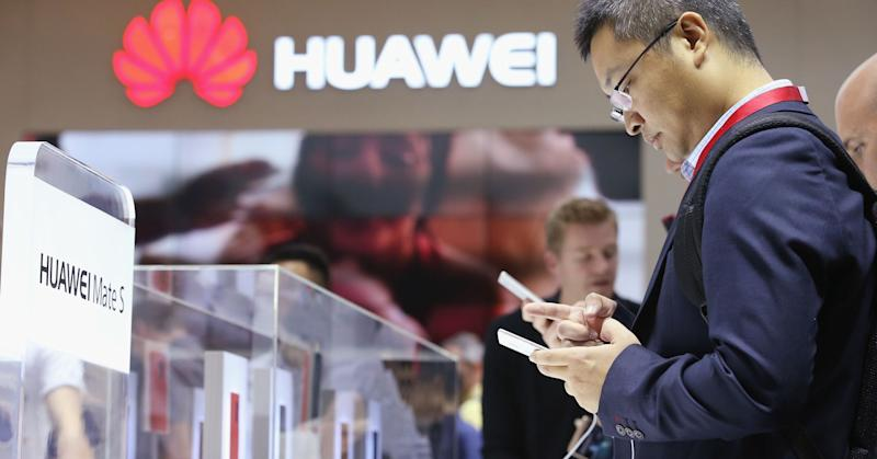 Visitors try out the Huawei Mate S smartphone.