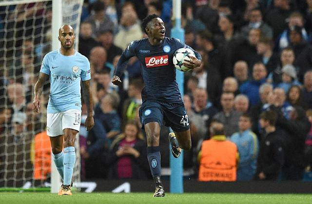 Napoli's midfielder Amadou Diawara celebrates scoring from the penalty spot against Manchester City on October 17, 2017 (AFP Photo/Oli SCARFF )