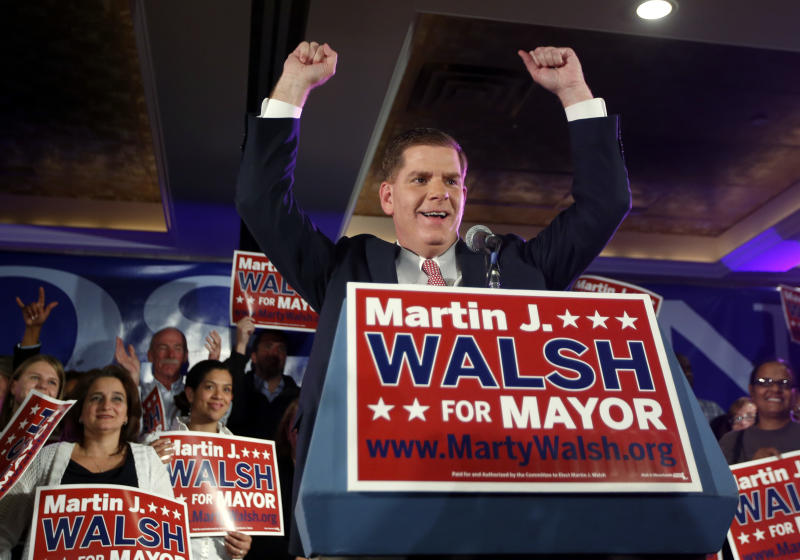 Boston Mayoral hopeful Martin Walsh gestures to supporters at his primary election night party in Boston, Tuesday, Sept. 24, 2013. The top two vote-getters in the preliminary election move on to compete in the Nov. 5 final. Current Boston Mayor Thomas Menino announced earlier this year that he would retire after more than 20 years in office. (AP Photo/Elise Amendola)