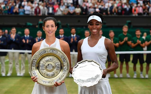 The two finalists pose for photos at the end of Saturday's match - AFP