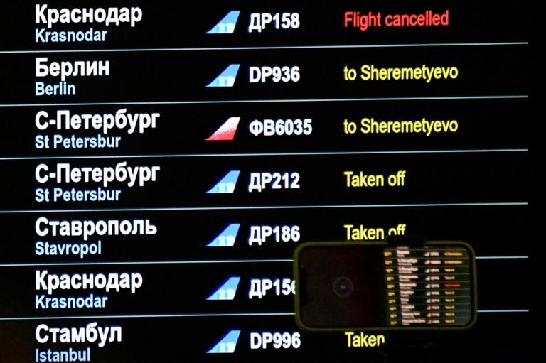 A notice was finally posted on the arrivals board confirming that Navalny's flight had been diverted
