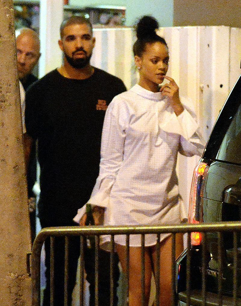 "<p>Drake and Rihanna followed up the nondiss kiss with a dinner date in NYC ? where RiRi wore Drake's tuxedo shirt from the night before! The couple then jetted off to Miami. At an afterparty for his concert, witnesses told <a href=""http://www.usmagazine.com/celebrity-news/news/rihanna-drake-hold-hands-after-making-out-at-miami-party-w437356"" rel=""nofollow noopener"" target=""_blank"" data-ylk=""slk:Us Weekly"" class=""link rapid-noclick-resp""><i>Us Weekly</i></a> the duo ""were making out and full-on kissing."" A source also told <a href=""http://www.people.com/article/rihanna-drake-miami-concert-date-night-afterparty"" rel=""nofollow noopener"" target=""_blank"" data-ylk=""slk:People"" class=""link rapid-noclick-resp""><i>People</i></a> they ""danced, kissed, and acted really coupley."" (Photo: INFphoto) </p>"