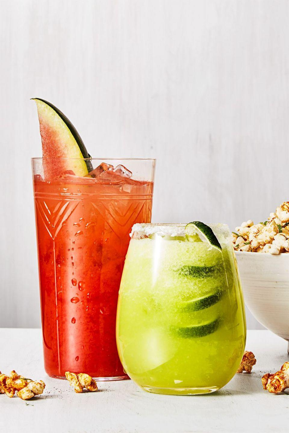 """<p>Light and fruity, you can enjoy these recipes all summer long. Both the tangy honeydew margarita and the sweet watermelon rum punch are equally refreshing served separately, but together you have a warm-weather treat that will satisfy everyone's taste.</p><p><em><a href=""""https://www.goodhousekeeping.com/food-recipes/a44182/honeydew-margarita-recipe/"""" rel=""""nofollow noopener"""" target=""""_blank"""" data-ylk=""""slk:Get the recipe for Honeydew Margarita »"""" class=""""link rapid-noclick-resp"""">Get the recipe for Honeydew Margarita »</a></em></p><p><em><em><a href=""""https://www.goodhousekeeping.com/food-recipes/a44185/watermelon-rum-punch-recipe/"""" rel=""""nofollow noopener"""" target=""""_blank"""" data-ylk=""""slk:Get the recipe for Watermelon Rum Punch »"""" class=""""link rapid-noclick-resp"""">Get the recipe for Watermelon Rum Punch »</a></em></em></p>"""