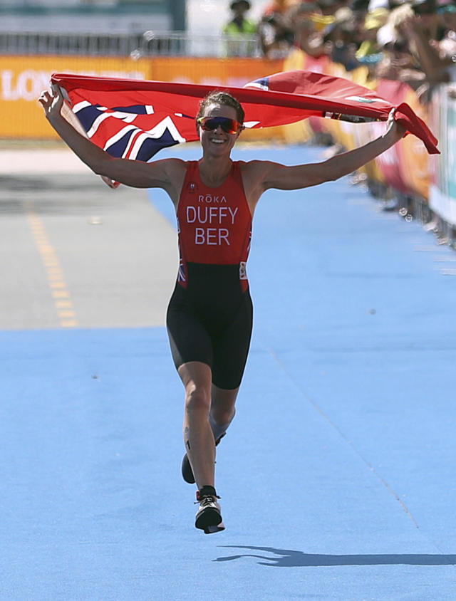 Flora Duffy of Bermuda celebrates as she wins the women's triathlon at Southport Broadwater Parklands in the 2018 Commonwealth Games on the Gold Coast, Australia, Thursday, April 5, 2018. (AP Photo/Mark Schiefelbein)
