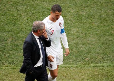 Soccer Football - World Cup - Group B - Portugal vs Morocco - Luzhniki Stadium, Moscow, Russia - June 20, 2018 Portugal's Cristiano Ronaldo talks to coach Fernando Santos as he walks off the pitch at half time REUTERS/Christian Hartmann