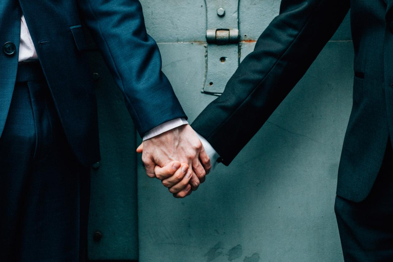 <p>At midnight on March 29 2014 gay marriage laws finally came into effect in Britain with several same-sex couples opting to tie the knot just moments afterwards. The Office for National Statistics (ONS) estimates that more than 1,400 couples legally married in the first three months after the law was granted. [Photo: Getty] </p>