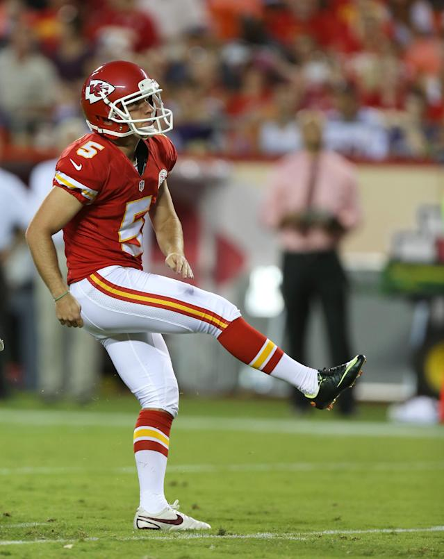 FILE - In this Aug. 23, 2014, file photo, Kansas City Chiefs kicker Cairo Santos (5) kicks during the first half of an NFL preseason football game against the Minnesota Vikings in Kansas City, Mo. Less than a year after his father was killed in a plane crash in Brazil, Cairo Santos has fulfilled both of their dreams. The undrafted rookie out of Tulane will be the starting kicker for the Chiefs on Sunday, Sept. 7, against Tennessee. (AP Photo/Ed Zurga, File)