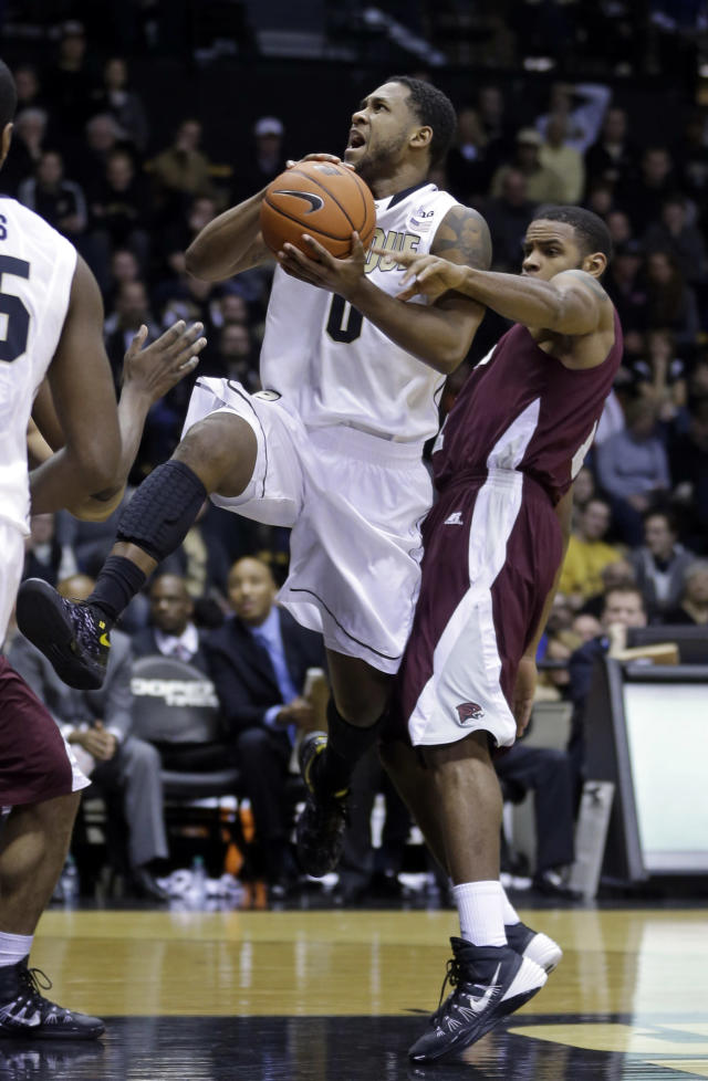 Maryland-Eastern Shore forward Iman Johnson, right, fouls Purdue guard Terone Johnson as he shoots during the second half of an NCAA college basketball game in West Lafayette, Ind., Tuesday, Dec. 17, 2013. Purdue defeated Maryland-Eastern Shore 79-50. (AP Photo/Michael Conroy)