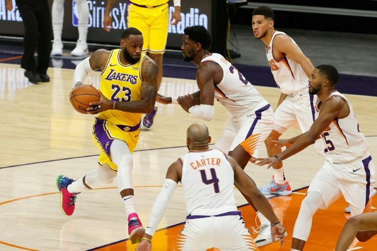 LeBron James will lead the Los Angeles Lakers' attempt to win back-to-back NBA championships as the season tips off on Tuesday