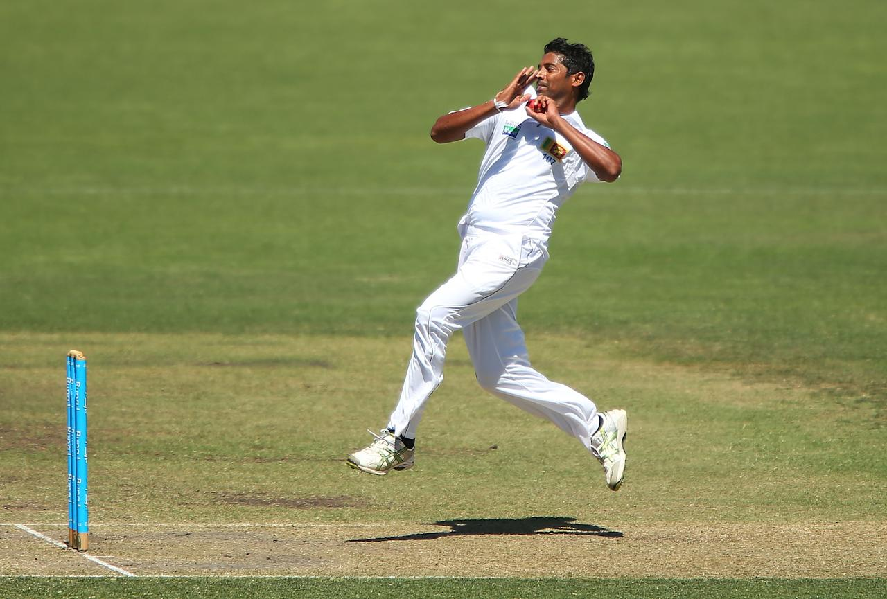 CANBERRA, AUSTRALIA - DECEMBER 06:  Chanaka Welagedara of Sri Lanka bowls during day one of the international tour match between the Chairman's XI and Sri Lanka at Manuka Oval on December 6, 2012 in Canberra, Australia.  (Photo by Brendon Thorne/Getty Images)