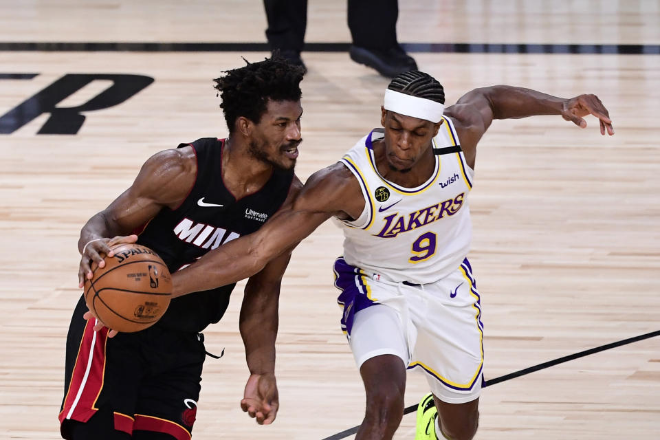 Jimmy Butler #22 of the Miami Heat dribbles against Rajon Rondo #9 of the Los Angeles Lakers during the second half in Game Three of the 2020 NBA Finals