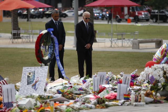 <p>The president and vice president pause after placing flowers at a memorial in Orlando, Fla., June 16, 2016. (AP/Pablo Martinez Monsivais) </p>