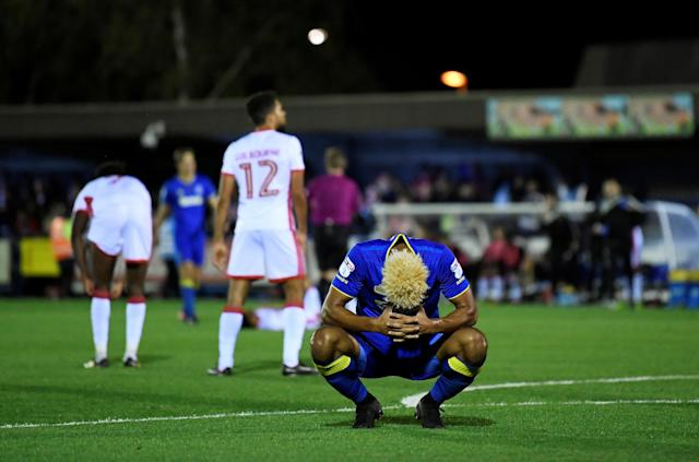 "Soccer Football - League One - AFC Wimbledon vs Milton Keynes Dons - Kingsmeadow, London, Britain - September 22, 2017 AFC Wimbledon's Lyle Taylor looks dejected after missing a penalty Action Images/Tony O'Brien EDITORIAL USE ONLY. No use with unauthorized audio, video, data, fixture lists, club/league logos or ""live"" services. Online in-match use limited to 75 images, no video emulation. No use in betting, games or single club/league/player publications. Please contact your account representative for further details."