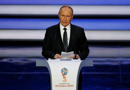 Soccer Football - 2018 FIFA World Cup Draw - State Kremlin Palace, Moscow, Russia - December 1, 2017 President of Russia Vladimir Putin during the draw REUTERS/Kai Pfaffenbach