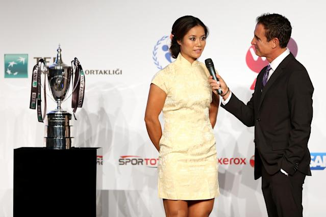ISTANBUL, TURKEY - OCTOBER 20: Na Li of China is interviewed by master of ceremony Andrew Krasny during the draw ceremony for the WTA Championships at the Renaissance Polat Hotel on October 20, 2013 in Istanbul, Turkey. (Photo by Matthew Stockman/Getty Images)