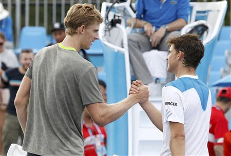 Kevin Anderson of South Africa (L) shakes hands with Dominic Thiem of Austria after defeating him in their men's singles match at the Australian Open 2014 tennis tournament in Melbourne January 15, 2014. REUTERS/Brandon Malone