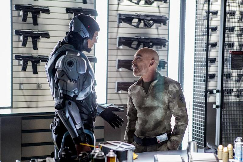 "This image released by Columbia Pictures shows Joel Kinnaman, left, and Jackie Earle Haley in a scene from ""RoboCop."" (AP Photo/Columbia Pictures - Sony, Kerry Hayes)"