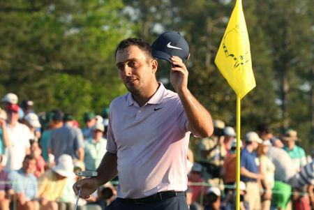 Golf - Masters - Augusta National Golf Club - Augusta, Georgia, U.S. - April 13, 2019 - Francesco Molinari of Italy tips his hat to the crowd as he finishes on the 18th green during third round play. REUTERS/Jonathan Ernst