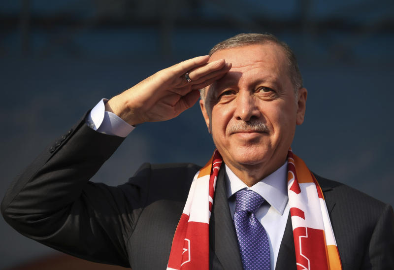 Turkish President Recep Tayyip Erdogan gives a military salute toward his supporters during a rally in Kayseri, Turkey, Saturday, Oct. 19, 2019. Turkish Red Crescent says it has delivered humanitarian aid for 2000 people in Syrian town of Ras Al-Ayn and says it also provided aid to Tal Abyad and will continue to do so in areas cleared from Syrian Kurdish fighters.(Presidential Press Service via AP, Pool )