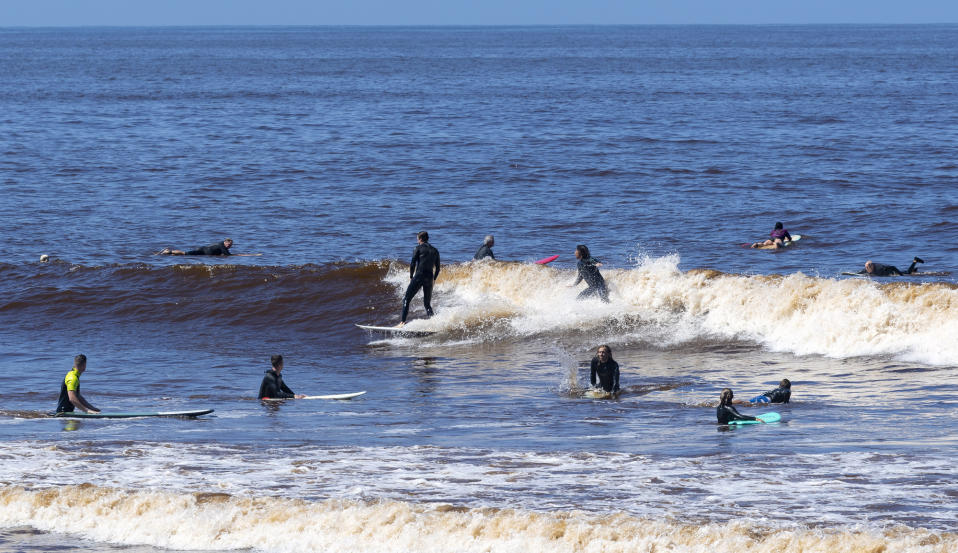 """SAN CLEMENTE, CA - MAY 05: Surfers were back on the waves at T Street in San Clemente, CA on Tuesday, May 5, 2020. The city opened its beaches for daily active use after coordinating with Gov. Gavin Newsom""""u2019s office to maintain social distancing during the COVID-19 (coronavirus) lockdown. (Photo by Paul Bersebach/MediaNews Group/Orange County Register via Getty Images)"""