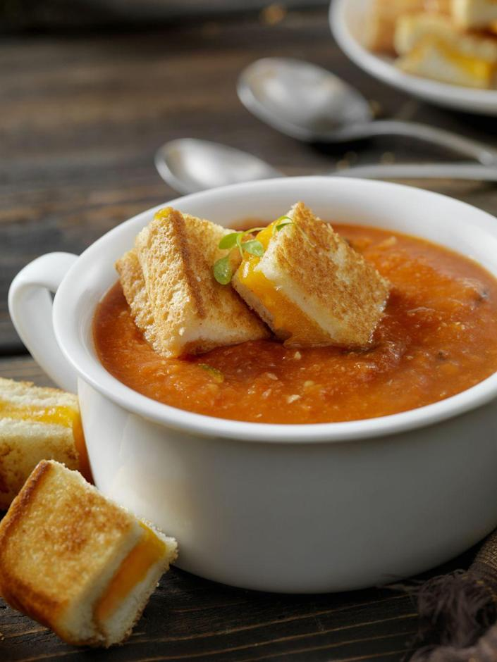 """<p>Bring the smoky flavor of the grill to both your grilled cheeses and your accompanying tomato soup with this recipe.</p><p><a href=""""https://www.womansday.com/food-recipes/food-drinks/recipes/a11862/grilled-tomato-soup-cheddar-sandwiches-recipe-122983/"""" rel=""""nofollow noopener"""" target=""""_blank"""" data-ylk=""""slk:Get the recipe for Grilled Tomato Soup and Cheddar Sandwiches."""" class=""""link rapid-noclick-resp""""><em><strong>Get the recipe for Grilled Tomato Soup and Cheddar Sandwiches.</strong></em></a></p>"""