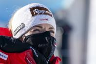Switzerland's Lara Gut-Behrami watches an alpine ski, women's World Cup super-G in St. Anton, Austria, Sunday, Jan.10, 2021. (AP Photo/Giovanni Auletta)
