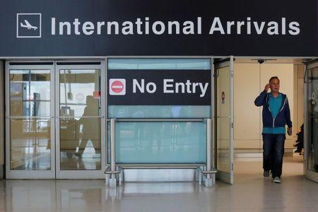 International travelers arrive on the day that U.S. President Donald Trump's limited travel ban, approved by the U.S. Supreme Court, goes into effect, at Logan Airport in Boston