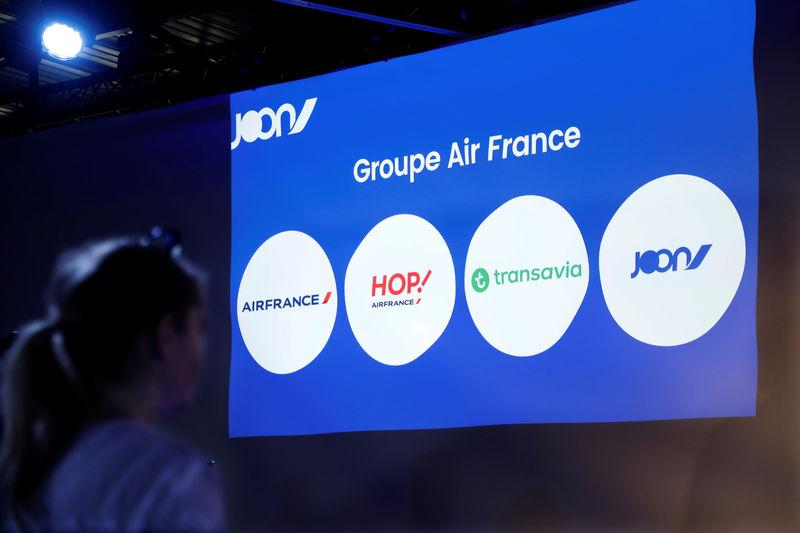 FILE PHOTO: Logos of Air France group airlines companies are projected on a screen during a news conference for the launching of Joon, the new lower-cost airline subsidiary of Air France in Paris