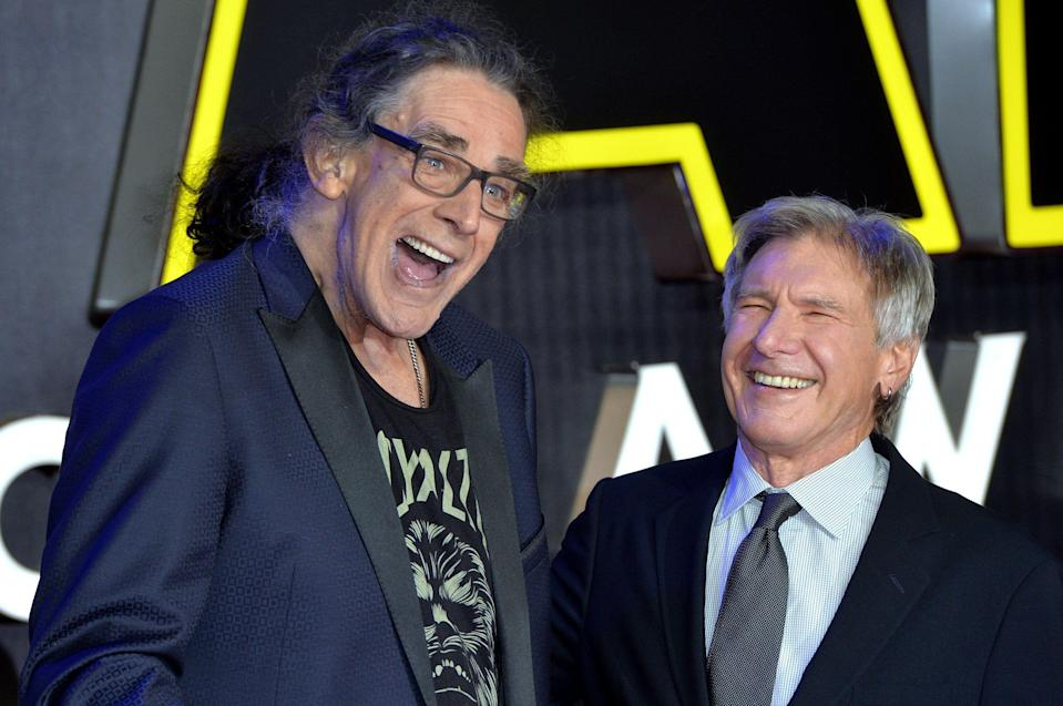 """LONDON, ENGLAND - DECEMBER 16:  Peter Mayhew and Harrison Ford attend the European Premiere of """"Star Wars: The Force Awakens"""" at Leicester Square on December 16, 2015 in London, England.  (Photo by Anthony Harvey/Getty Images)"""