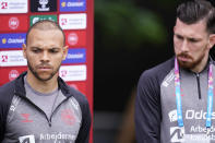Danish players Martin Braithwaite, left, and Pierre-Emile Hojbjerg attend a press conference, in Elsinore, Denmark, Monday, June 14, 2021. Denmark played their opening Euro 2020 group game against Finland on Saturday when during the first half Denmark's player Christian Eriksen's heart stopped and and was given lengthy medical treatment before regaining consciousness. (Liselotte Sabroe/Ritzau Scanpix via AP)