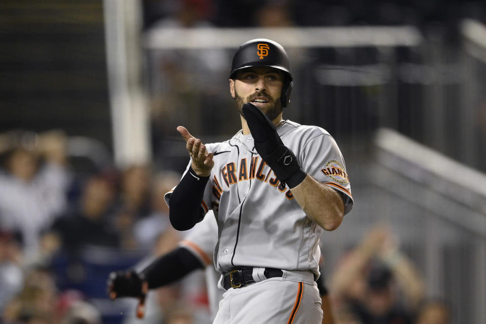 San Francisco Giants' Curt Casali reacts after he scored on a single by LaMonte Wade Jr. during the eighth inning of the second baseball game of a doubleheader against the Washington Nationals, Saturday, June 12, 2021, in Washington. The Giants won 2-1 in eight innings. (AP Photo/Nick Wass)