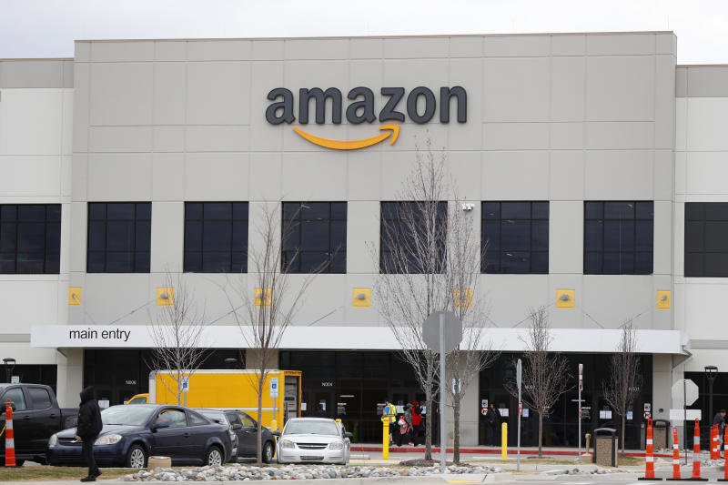 The Amazon DTW1 fulfillment center is shown in Romulus, Mich., Wednesday, April 1, 2020. Employees and family members are protesting in response to what they say is the company's failure to protect the health of its employees amid the new coronavirus COVID-19 outbreak. (AP Photo/Paul Sancya)