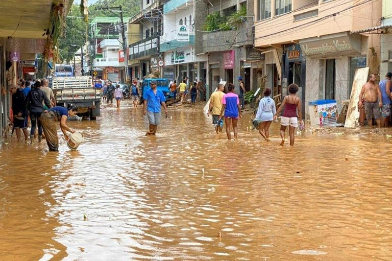 Handout picture released on January 18, 2020 by Espirito Santo State Government showing a flooded street after heavy rain and floods, at the city of Iconha, state of Espirito Santo, Brazil