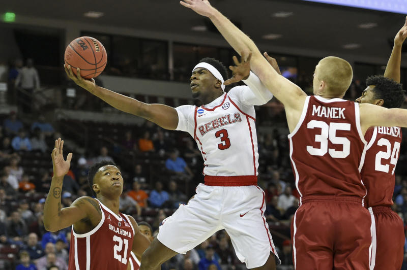 Mississippi's Terence Davis (3) shoots past Oklahoma's Brady Manek (35) and Kristian Doolittle (21) during a first-round game in the NCAA mens college basketball tournament in Columbia, S.C. Friday, March 22, 2019. (AP Photo/Richard Shiro)