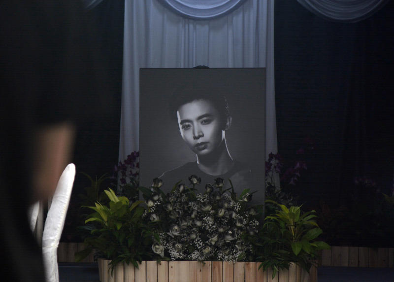 A photograph of Singapore actor Aloysius Pang is displayed at his public memorial in Singapore Saturday, Jan. 26, 2019. Pang died from injuries sustained during a military training exercise in New Zealand on Thursday. (AP Photo/Annabelle Liang)