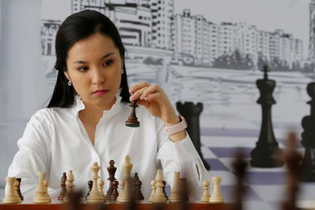 Kazakh chess player and social activist Dinara Saduakassova poses for a picture in the Chess Academy in Nur-Sultan