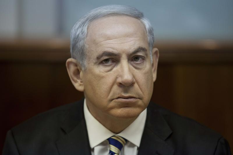 FILE -This Sept. 1, 2013 file photo shows Israeli Prime Minister Benjamin Netanyahu during the weekly cabinet meeting in Jerusalem, Israel. Mortified that the world may be warming up to Iran, Netanyahu is taking an unpopular message to the White House and the United Nations this week: Don't be fooled by Tehran's new leadership. With the White House cautiously optimistic about its dialogue with Iran, the meeting on Monday, Sept 30, 2013 between Netanyahu and President Barack Obama could be tense. (AP Photo/Abir Sultan, Pool, file)