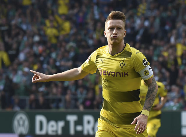Dortmund's Marco Reus celebrates after scoring the opening goal during the German Bundesliga soccer match between SV Werder Bremen and Borussia Dortmund, in Bremen, Germany, Sunday, April 29, 2018. (Carmen Jaspersen/dpa via AP)